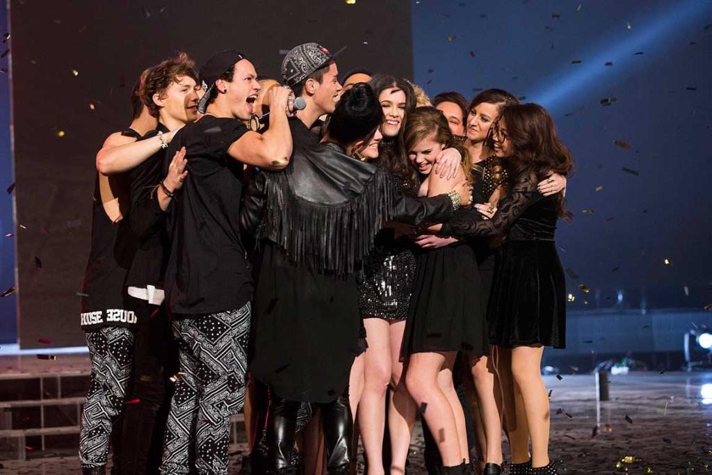 The final 12 acts congratulate Jackie Thomas after she was announced as the winner of the X Factor.