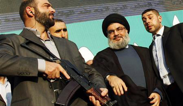 TERROR: Lebanon's Hezbollah leader Sayyed Hassan Nasrallah (second right), escorted by his bodyguards, greets his supporters at an anti-US protest.