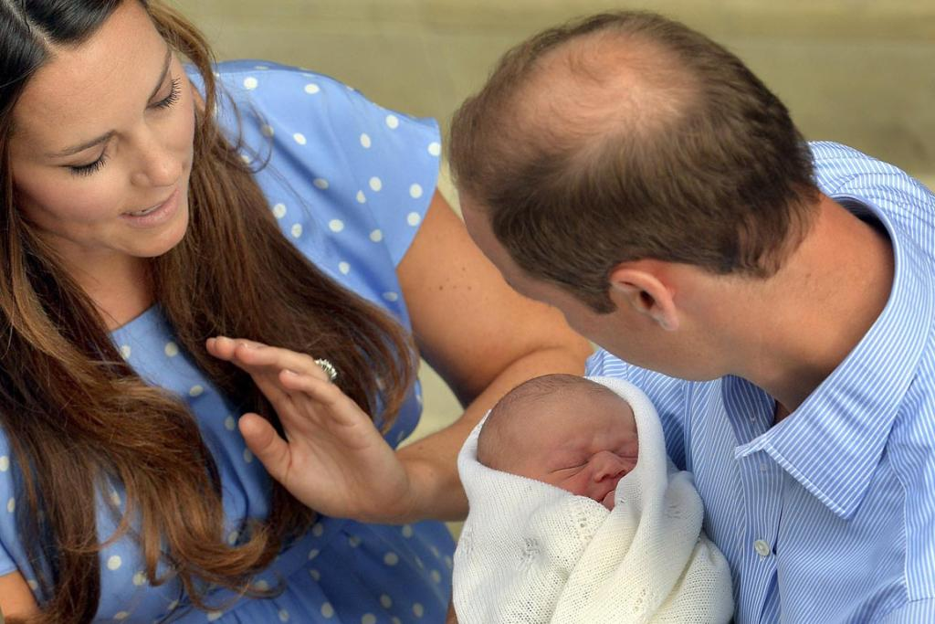 Britain's Prince William holds his baby son outside the Lindo Wing of St Mary's Hospital before leaving with Catherine, Duchess of Cambridge, in central London.