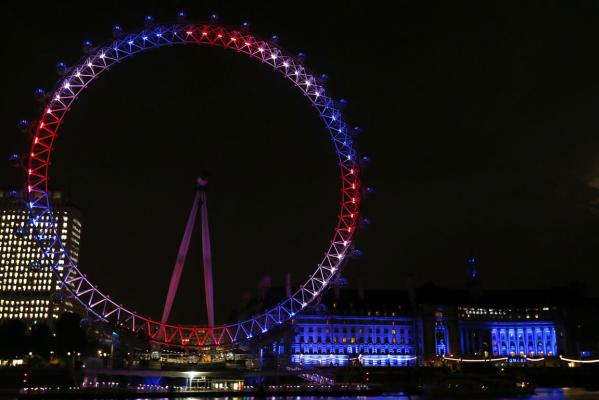 The London Eye is lit in red, white and blue after Catherine, Duchess of Cambridge gave birth to a baby boy at St Mary's Hospital in central London.