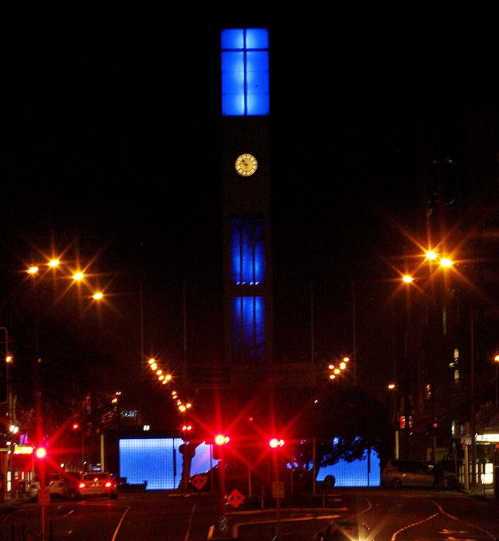 Palmerston North's clock tower glows blue for the royal boy's birth.