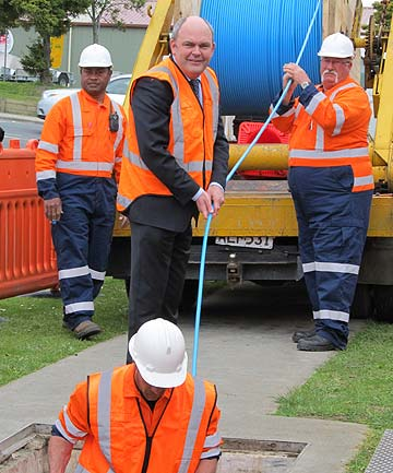 GETTING CONNECTED: Then Minister for Communications and Information Technology Steven Joyce helps lay the first ultra fast broadband fibre optic cable in Albany's industrial area in 2011.