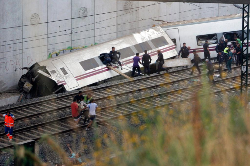 Rescue workers race to free all the passengers trapped in the smashed train.