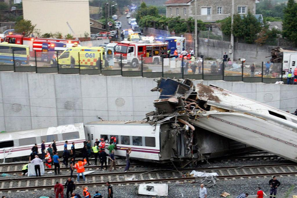 Rescue workers pull victims from the wreckage of the train, which crashed near Santiago de Compostela, Spain.