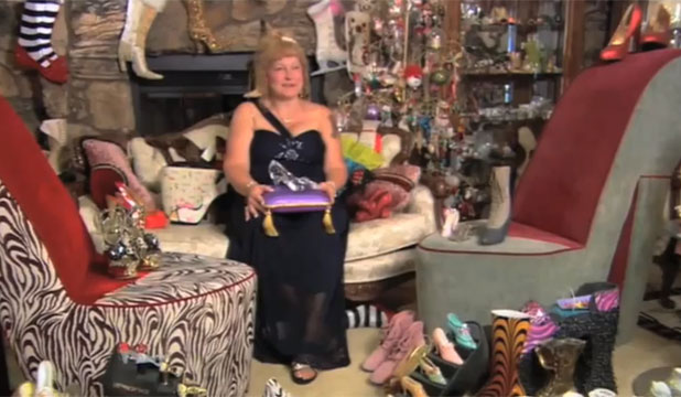 I LOVE SHOES: Darlene Flynn pictured with some of her record breaking collection.