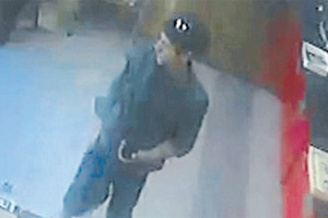 CAUGHT ON CAMERA:  A security camera shot of a man who allegedly stole a charity box from a Nelson Bakery.