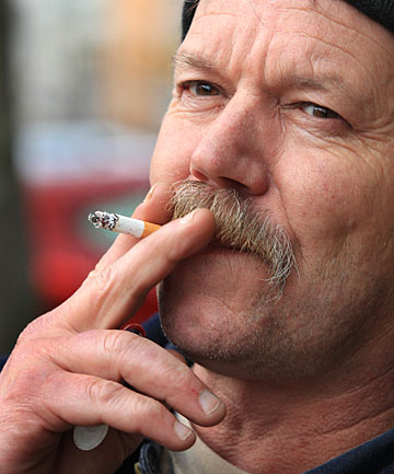 SMOKO: Greg North, of Stewart Island, has a cigarette break while visiting Invercargill this week.
