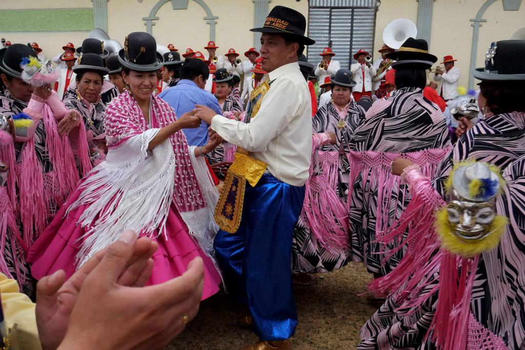 Devotees dance during a celebration before the Festival for Apostle Santiago (the Apostle James) in Guaqui, on the shores of the Titicaca Lake, Bolivia.