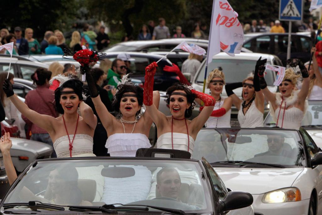 Women in bridal gowns take part in the annual wedding parade in central Minsk.
