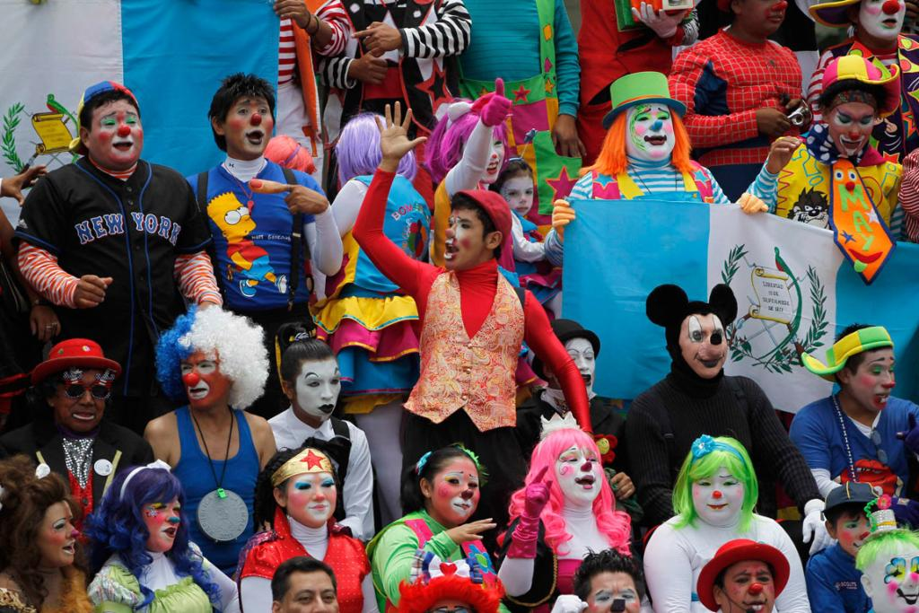Clowns gather for a group photo after a parade to inaugurate the 5th Annual Clowns' Convention in Guatemala City.
