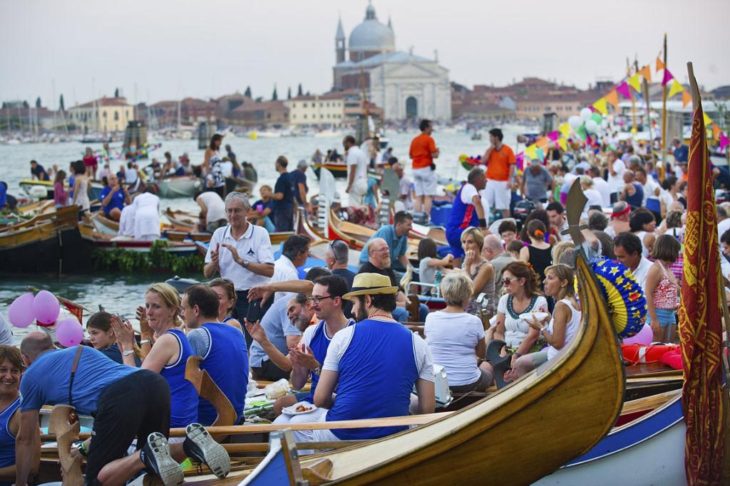 People gather on boats of all sizes at Punta della Dogana in St. Mark's Basin for the Redentore Celebrations in Venice, Italy.