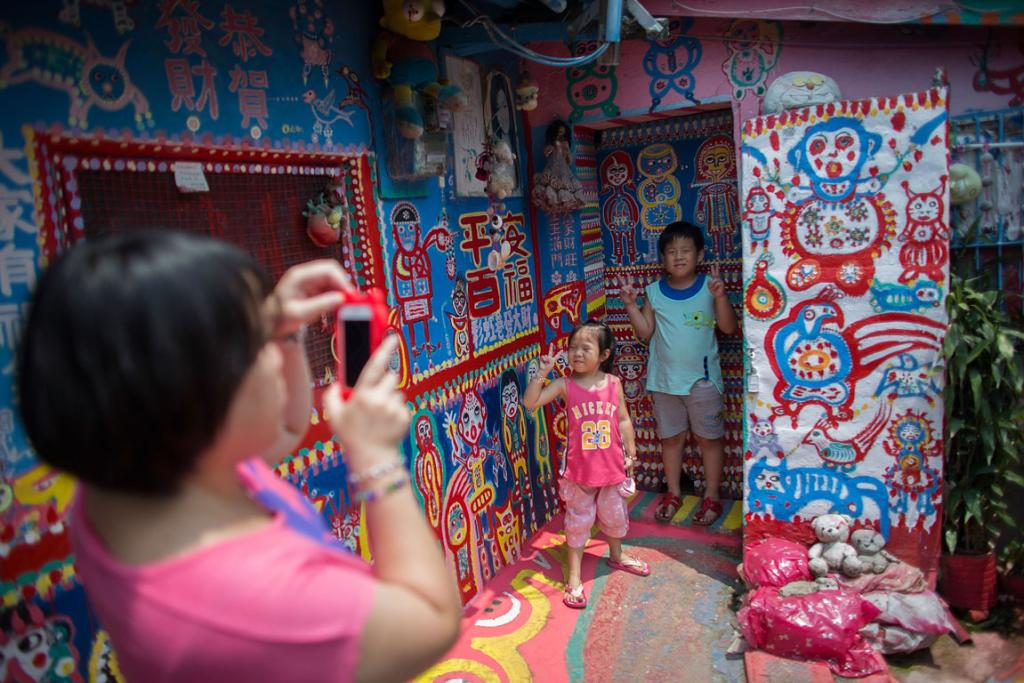 Tourists visit the Rainbow Military Dependents' Village in Taichung in Taiwan.