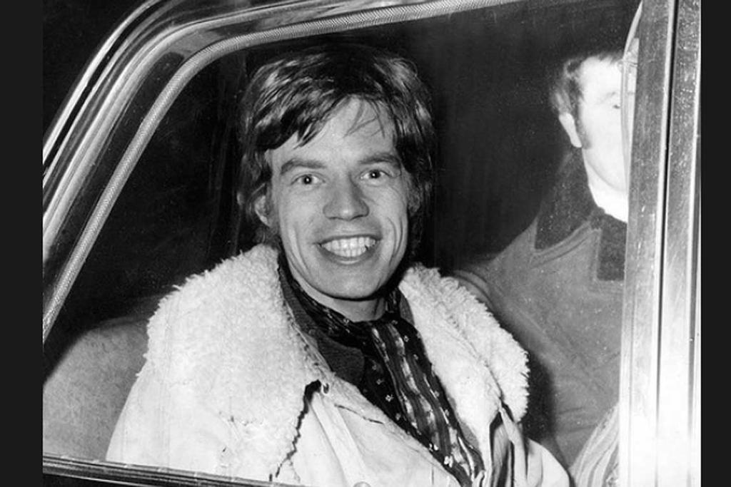 """Clean-shaven and relaxed after a day's filming, Mick Jagger leaves the old city gaol during the filming of """"Ned Kelly"""", 1969."""