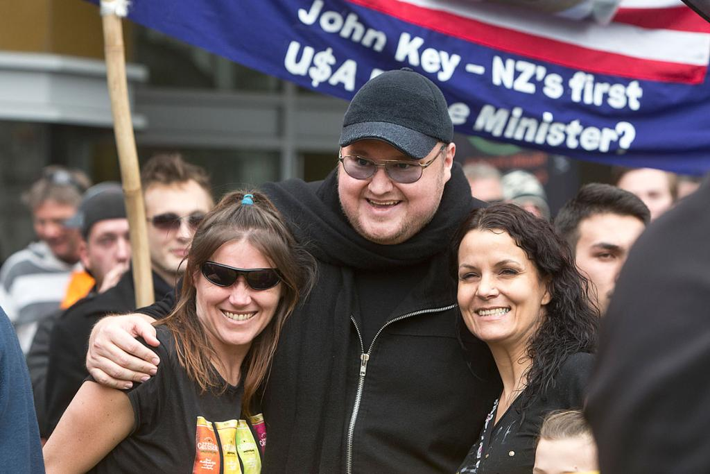 SMILE NOW: Kim Dotcom poses for photos during the Auckland protest against the GCSB spying bill.