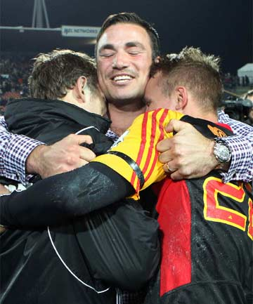BIG RELIEF: Injured Richard Kahui hugs Chiefs team-mates Andrew Horrell and Robbie Robinson after their 20-19 Super Rugby semifinal victory over the Crusaders.
