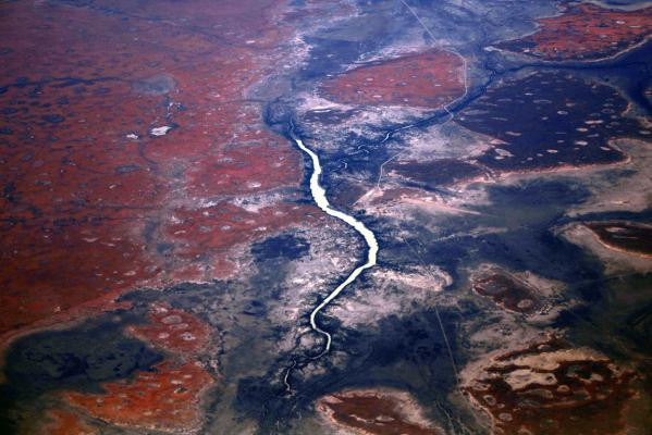 A river is seen flowing among sand dunes in the Tanami Desert located in Australia's Northern Territory.