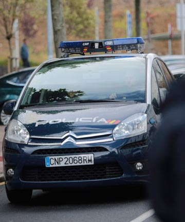 FACING A JUDGE: A police car arrives at the courthouse with Francisco Garzon inside in Santiago de Compostela, northwestern Spain.