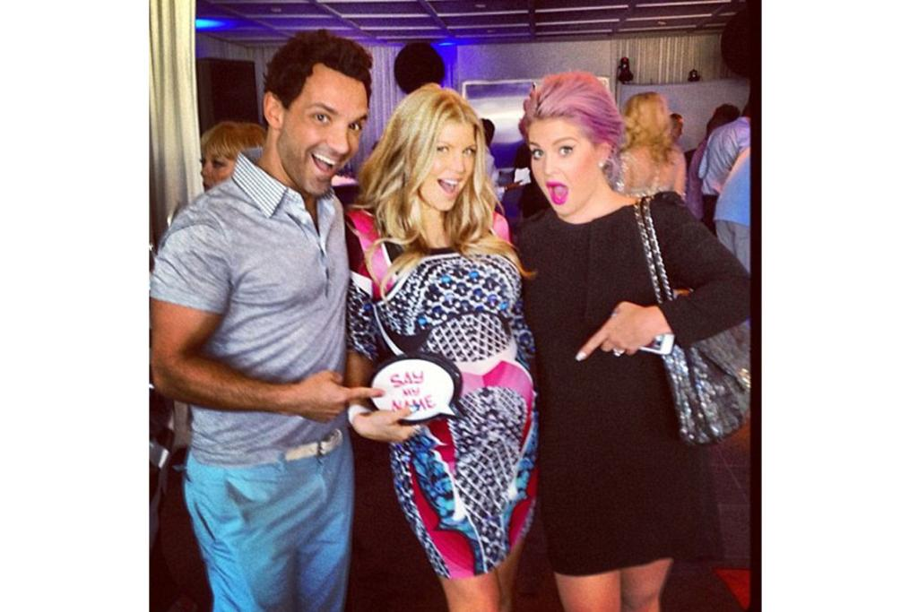FASHION POLICE: George Kotsiopoulos, one of the stars of E! Entertainment TV show Fashion Police tweeted this pic with co-star Kelly and hostess, Fergie, calling it the 'best #GaybyShower ever!!!'