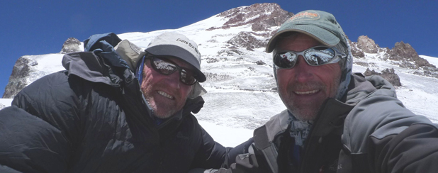 Graeme Giles, left, is guided up the summit of the Mount Aconcagua middle peak by adventurer and tour guide Marty Schmidt.