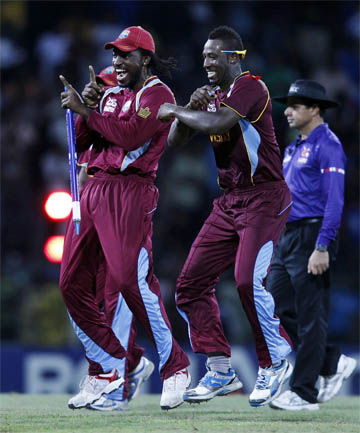 REASON TO DANCE: Chris Gayle (left) and Andre Russell celebrate the West Indies World T20 semifinal win over Australia.