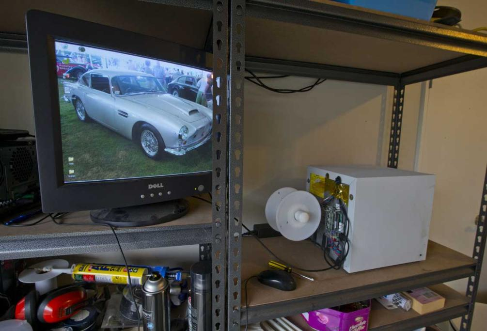 The 3D printer to the right and an original Aston Martin that Ivan Sentch is attempting to replicate in his garage on Auckland's North Shore.