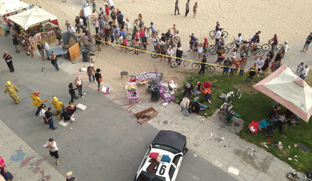 DEADLY SITE: Injured pedestrians are attended to after a car crashed into pedestrians on the boardwalk in Venice Beach, California.