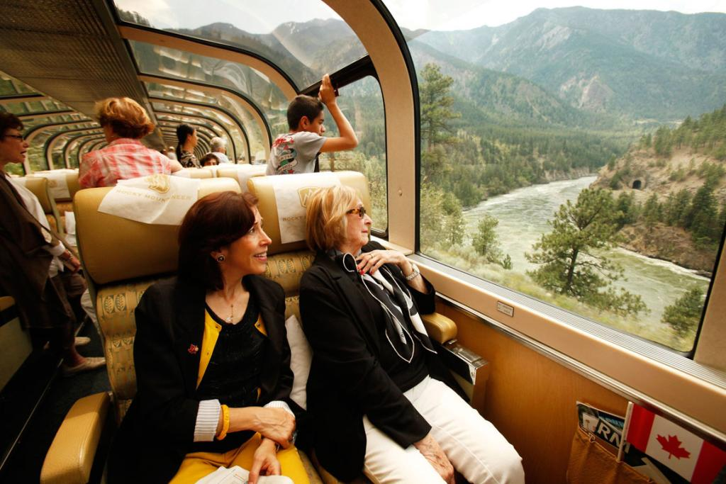 Guests travel in a bi-level, glass-dome topped car.