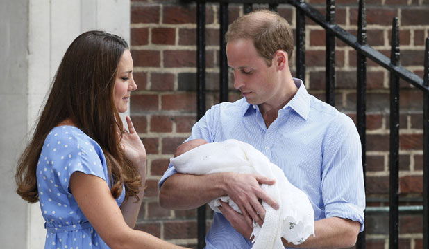 HIS ROYAL HIGHNESS: Prince William and Catherine, Duchess of Cambridge hold Prince George of Cambridge outside of the Lindo Wing of St Mary's Hospital in London July 23.