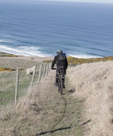 EXHILARATING: Mountainbiking down to the beach, on the peninsula's wild side.