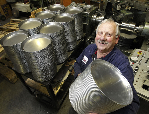 EXPORT ORDER: Basil Jones with part of a large Australian export order of pizza base tins.
