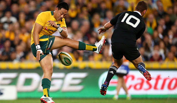 Aaron Cruden feels the pain as he charges down a kick from the Wallabies' Christian Lealiifano in the first Bledisloe Test.