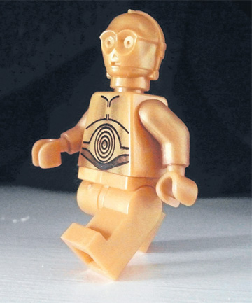 C3PO is as surprised as us to learn that you can make many of the Star Wars vehicles from recycled materials like paper cups and wooden stirrers.