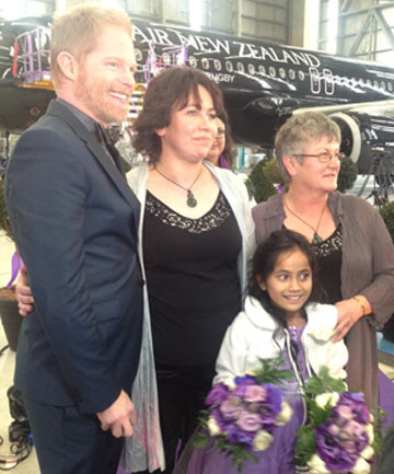 MELDING MODERNITY: Modern Family star Jesse Tyler Fergusson with the happy couple Lanley Bendall and Ally Wanikau and their daughter, Maycee, after their historic marriage on an Air NZ flight.