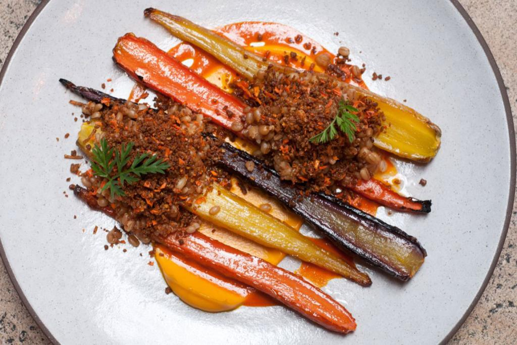 Slow roasted carrots, wheat berries, crispy duck skin and cumin at the Nomad Hotel in March.