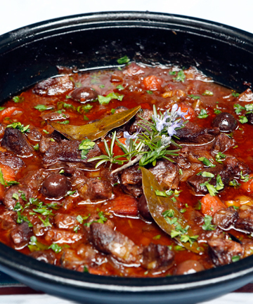 BUBBLING AWAY: Italian braised beef fills the kitchen with the aromas of cooking.