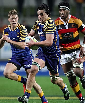 ON THEIR WAY: Otago flanker Lee Allen makes a charge against the Waikato defence.