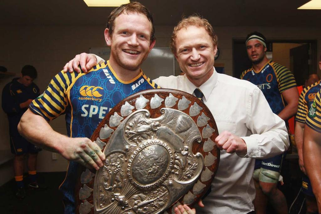 Utility back Peter Breen and coach Tony Brown pose with the Shield.