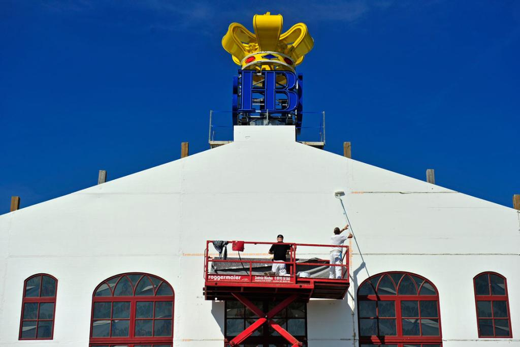 Painters work outside the Hofbraeu beer tent during the preparation for the 2013 Oktoberfest.