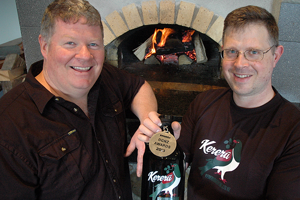 Hot stuff: Art of Pizza owner Chris Chevalier and Kereru Brewing Company owner Chris Mills with a beer that won a silver medal at the Brewers Guild of New Zealand awards.