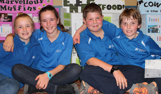 Limehills School students Bella Dykes, Ella Wilson, Alex Dykes and Lachlan Thomson celebrate after winning awards at the science and technology fair.