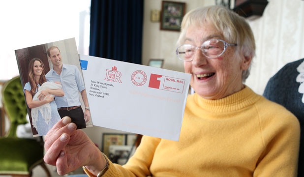 Windsor resident Wilma Queale with a royal thank you postcard.