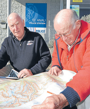 Former Te Anau police constable Lloyd Matheson, left, and helicopter pilot Bill Black reminisce about a search still awaiting conclusion.