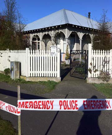 CORDONED: The Invercargill house where a baby was hurt.