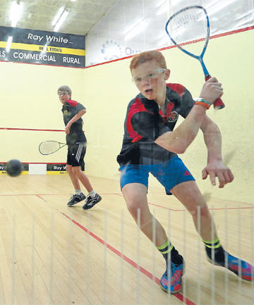 Cody McKenzie (Southland Boys' High School) plays a shot in his game against Jack Demchy (James Hargest College) at the Southland secondary schools squash championships at Squash City, Invercargill.