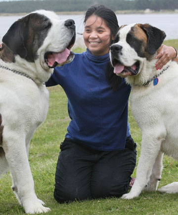 NOT HELPED: Sucharitta Milton, pictured here in 2010 with her dogs, was sent home in pain from Southland Hospital on Sunday.