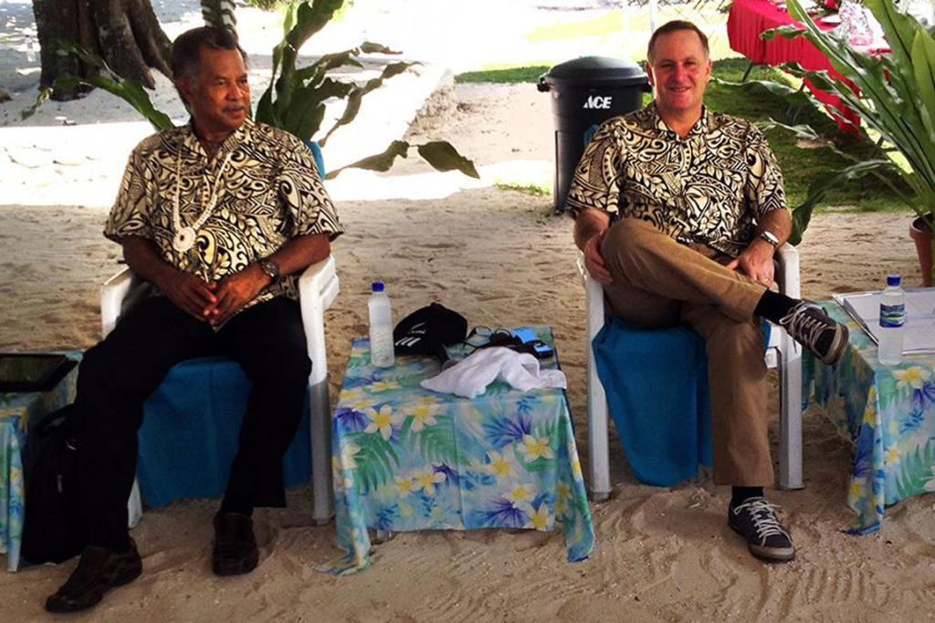 Cook Islands Prime Minister Henry Puna and Prime Minister John Key relaxed in the shade