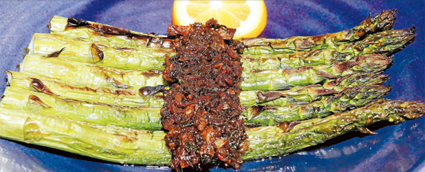 FRESH FLAVOURS: Grilled asparagus with anchovies and lemon