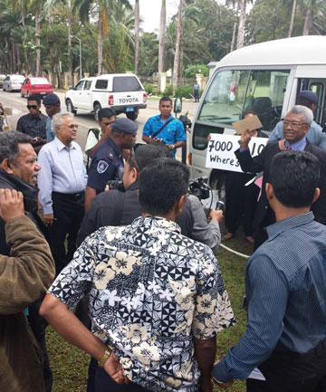 Police move in to arrest the demonstrators, including former prime minister Mahendra Chaudhry (in light-coloured shirt) and Tupeni Baba (by the door, holding up a petition).