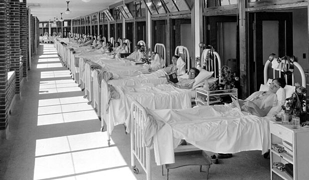 CHANGING TIMES: Fresh air was a part of the regimen to battle tuberculosis. Patients receive fresh air treatment on the sun porch at Waverly Tuberculosis Hospital in the 1950s.
