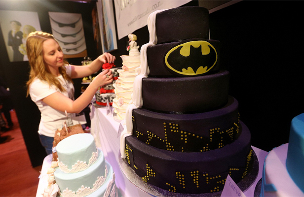 Caked crusader: Becs Peel of Stiletto Studio and a batman cake at the wedding show at Shed 6.